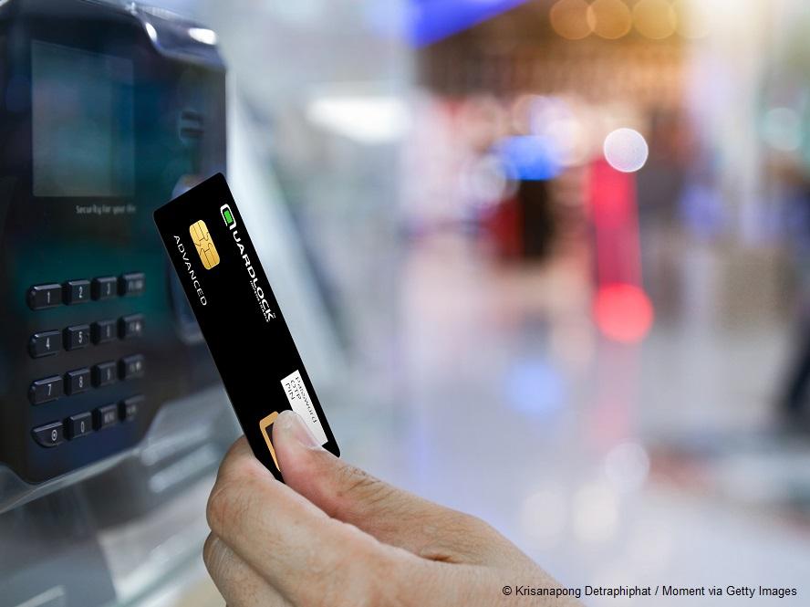 Businessman hand scanning finger on machine,Technology concept,