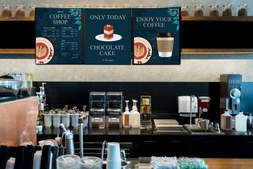 Behind the coffee bar in dark tone interior.